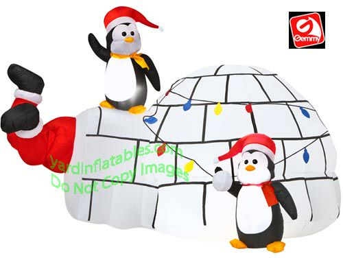animated_santa_kicking_outside_igloo_penguin_gemmy_airblown_inflatable_89354_2